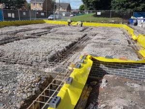 Commercial Builders preparing foundations for concrete