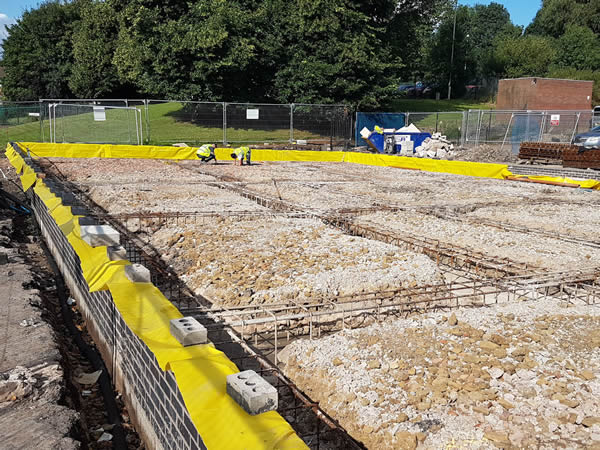 Builders get trenches ready for concrete to form foundations