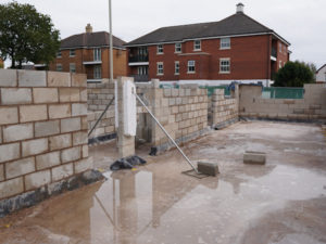 Blockwork construction taking place on a new build