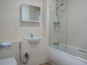 The internal fit-out of a bathroom as part of a new construction project